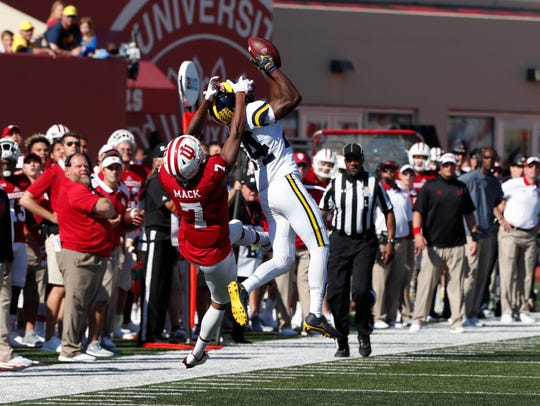Michigan's Lavert Hill intercepts a pass against Indiana