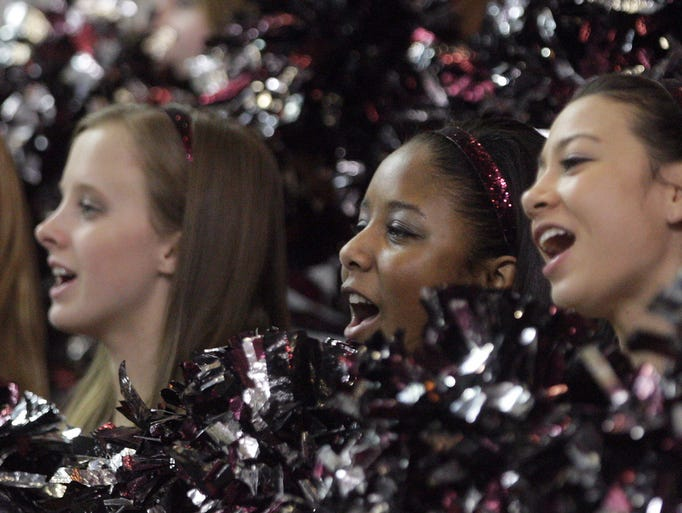 Caravel cheerleaders work for their side against Sanford in a DIAA state high school tournament semifinal Wednesday, March 5, 2014 at the Bob Carpenter Center.