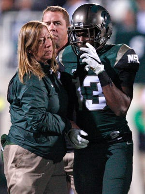Sep 12, 2015; East Lansing, MI, USA; Michigan State Spartans cornerback Vayante Copeland (13) walks off the field with an injury during the fourth quarter against the Oregon Ducks at Spartan Stadium. The Spartans beat the Ducks 31-28.