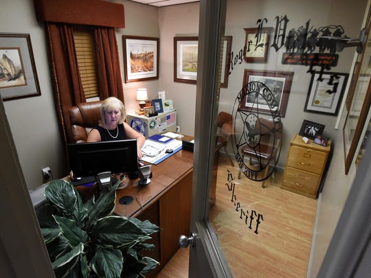 Marion County Sheriff Joan Vickers works in her office on Monday. Her late-husband, Roger, had sat in that seat since taking office in 2009.