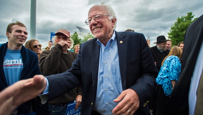 Democratic presidential candidate Vermont Sen. Bernie Sanders greets supporters at the Burlington International Airport in South Burlington on Wednesday, June 8, 2016.