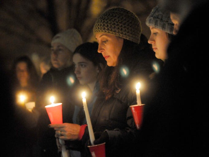 Michelle Kiernan of Grosse Pointe Woods holds a candle
