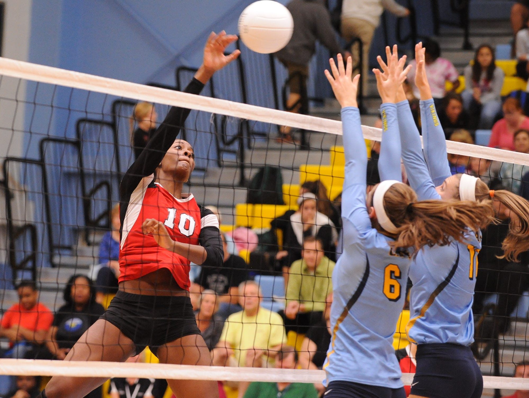 Conrad's #10 Amiya Rattley with a spike in the third game against Cape Thursday night at Cape Henlopen High School.
