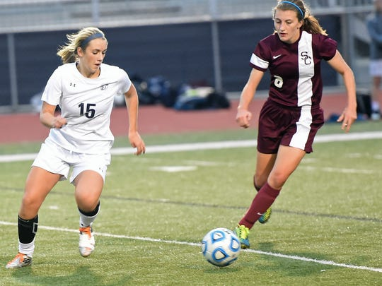 Chambersburg's Claire Jacobs (15) goes for a loose