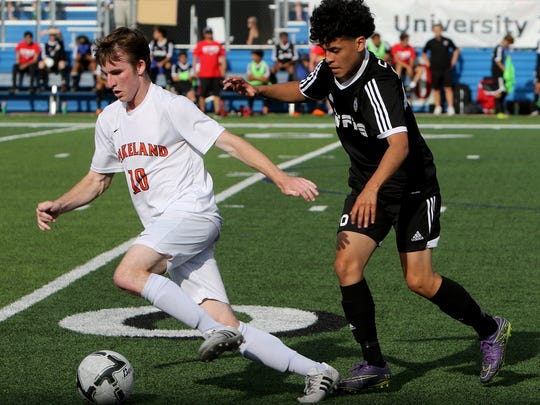 Frisco Wakeland's Matt Ribble dribbles upfield while followed by Wichita Falls High School's Jose Luevano in the UIL Soccer State Championship semifinal Thursday, April 13, 2017, at Birkelbach Field in Georgetown.