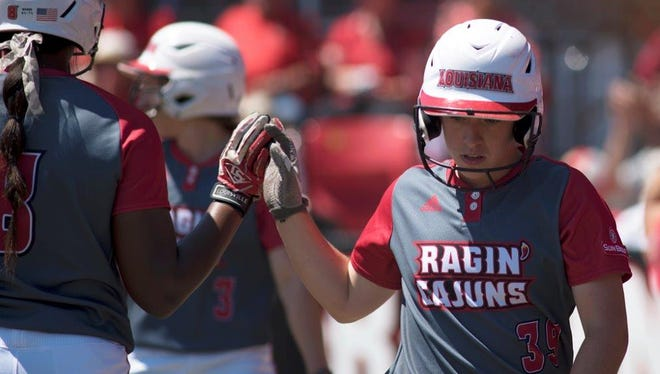 UL freshman third baseman Kara Gremillion celebrates scoring with teammate Aleah Craighton during Saturday's doubleheader sweep of UL Monroe.