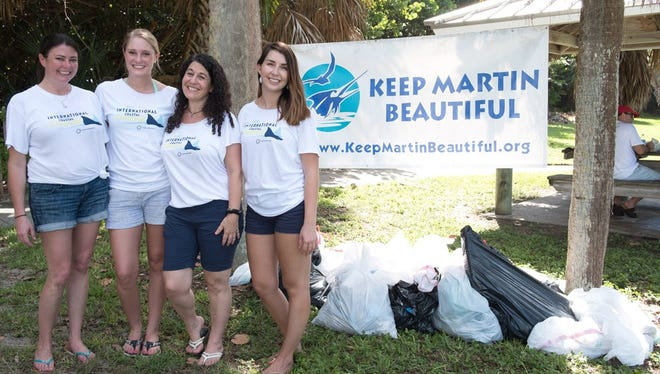 Volunteers Megan Morris (from left), Jordan Pinkston, Stacy Ranieri, and Tiffany Smith gather during Keep Martin Beautiful's 21st annual International Coastal Cleanup on Sept. 17.