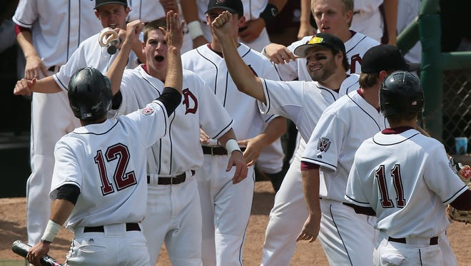Dowling celebrates a run with Zevon Benoit in their 4A quarterfinal against Iowa City West Wednesday, July 30, 2014.