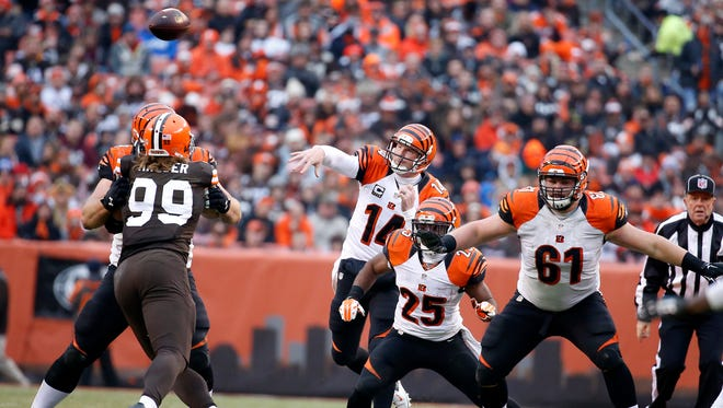The Cincinnati Bengals quarterback Andy Dalton (14) gets off a pass against the Cleveland Browns in the third quarter at FirstEnergy Stadium. The Enquirer/Jeff Swinger
