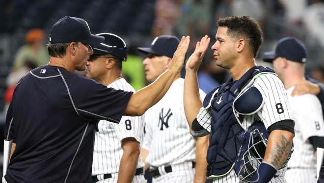 New York Yankees catcher Gary Sanchez, right, celebrates with teammates after the Yankees defeated the Cleveland Indians 13-7 in a baseball game Friday, Aug. 5, 2016 in New York.
