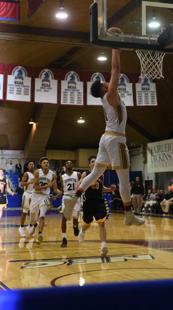 BJ Saliba (with ball) and Hackensack clinched the Big