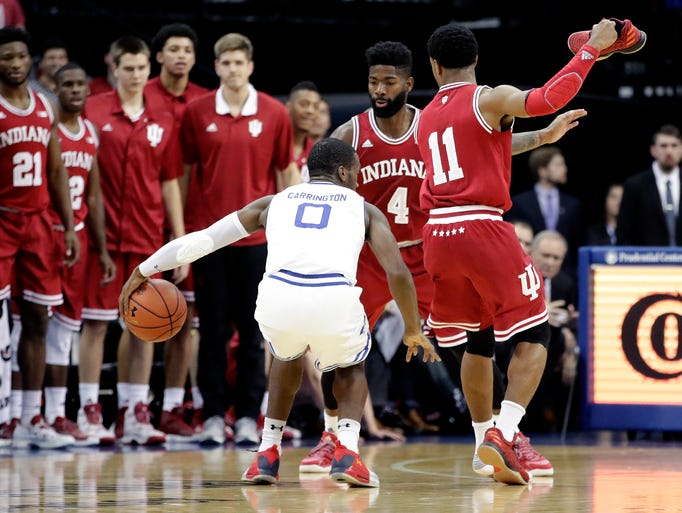 Indiana guard Devonte Green (11) holds his shoe on