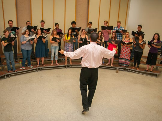 New Mexico State University's new  Director of Choral Studies John Flanery rehearses  with  the University Singers for a concert at 7:30 p.m. Oct. 16 at  Atkinson Music Center.