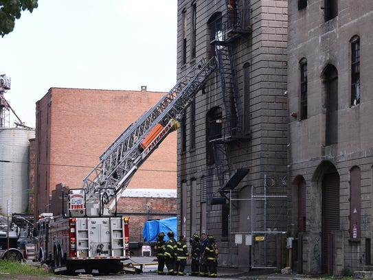 Paterson firefighters respond to a fire at an abandoned