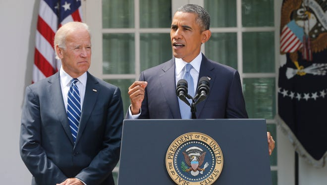 President Obama stands with Vice President Joe Biden as he makes a statement about Syria in the Rose Garden at the White House in Washington, Saturday, Aug. 31, 2013.