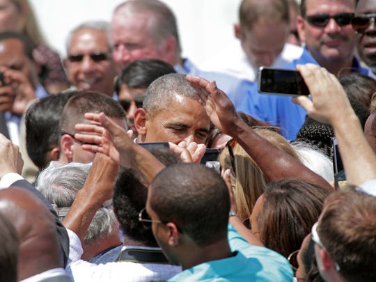 President Obama shakes hands with audience members after giving a speech at the Port of Wilmington.