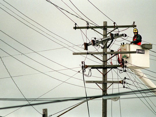 Wis. Electric Power Co. Employees repair lines