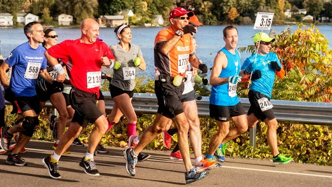 Runners take part in a recent Wineglass Marathon. Registration opens Monday for the 2015 race weekend.