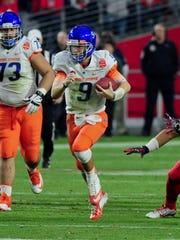 Boise State quarterback Grant Hedrick (9) runs against Arizona in the 2014 Fiesta Bowl.