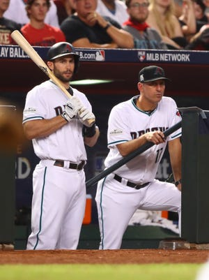 Oct 4, 2017: Arizona Diamondbacks first baseman Paul Goldschmidt (left) and manager Torey Lovullo against the Colorado Rockies in the 2017 National League wildcard playoff baseball game at Chase Field.