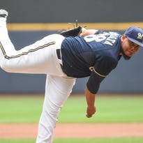 Aug 30, 2015; Milwaukee, WI, USA; Milwaukee Brewers pitcher Wily Peralta (38) pitches in the first inning against the Cincinnati Reds at Miller Park. Mandatory Credit: Benny Sieu-USA TODAY Sports