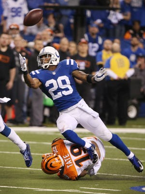 Indianapolis Colts strong safety Mike Adams breaks up a big third down pass intended for Cincinnati Bengals wide receiver Brandon Tate in the third quarter. Indianapolis hosted Cincinnati in the first round of the NFL Playoffs Sunday, January 4, 2015.