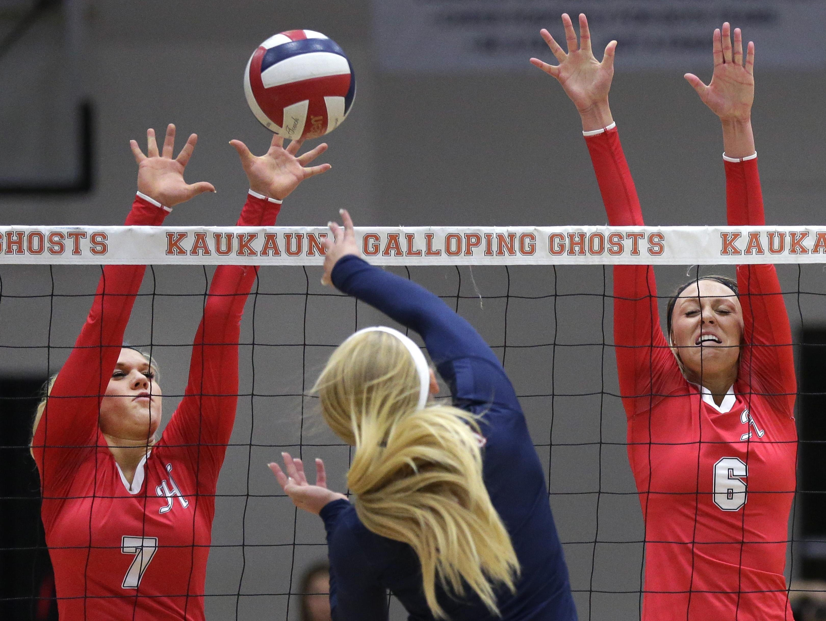 Hortonville's Mandy Behm (left) and Madi Walter (right) try to block a hit by Appleton East's Tricia Dailey during a WIAA Division 1 sectional semifinal Thursday in Kaukauna. To see more photos and video from the match, go to postcrescent.com.