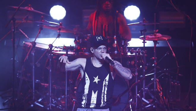 Singer-songwriter Rene Perez Joglar, also known as Residente, performs during his concert at the Auditorio Nacional in Mexico City. Residente leads Latin Grammys nominations with nine nods that include record, song and album of the year.