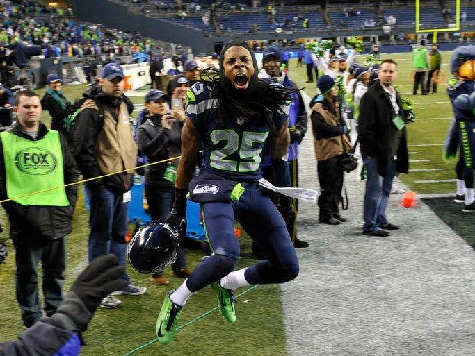 Seattle Seahawks cornerback Richard Sherman (25) celebrates after the 2013 NFC divisional playoff football game against the New Orleans Saints at CenturyLink Field. The Seahawks defeated the Saints 23-15.