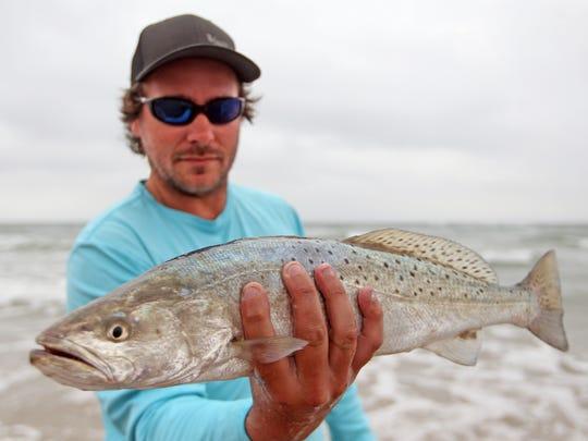 Matt Redus of San Antonio caught several surf trout on topwater plugs.