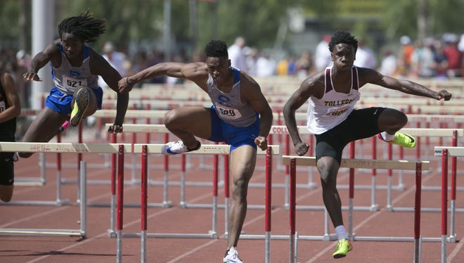 Chandler's Edwin Adams (L-R), Chandler's TJ Green, and Tolleson's Trey Johnson race in the Division I 110 Meter Hurdles during the State Championships for Track and Field on May 6, 2017 at Mesa Community College in Mesa, Ariz. Green would finish first followed by Johnson then Adams.