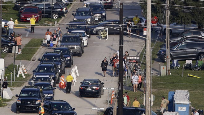 A line of traffic waits to enter Gate 2 prior to the 100th running of the Indianapolis 500 at Indianapolis Motor Speedway on May 29, 2016.