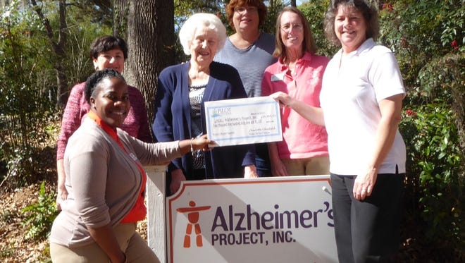 Pictured left to right, back row:  Debbie Moroney, CEO Alzheimer's Project, Inc.; Jane Furlong, Pilot;  Pam Schilling, Pilot; Claire Mikko, Pilot Front row:  Charlotte Edenfield, President, Pilot Club of Tallahassee, Jasmine Sheppard, Program Manager Alzheimer's Project, Inc.
