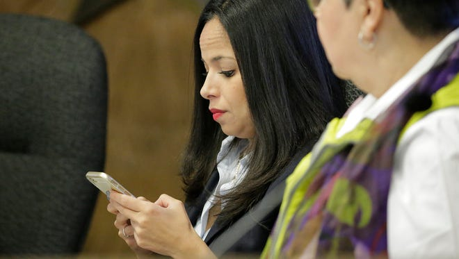City Rep. Claudia Ordaz uses her phone during a recent city council meeting where Barbara Carrasco raised questions about Ordaz texting County Judge Veronica Escobar during Executive Session meetings that she was a part of.