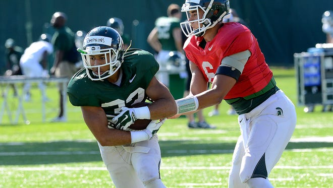 MSU running back Nick Tompkins takes a handoff from quarterback Damion Terry during an August practice. The fifth-year senior has carried just six times for 16 yards in his MSU career.