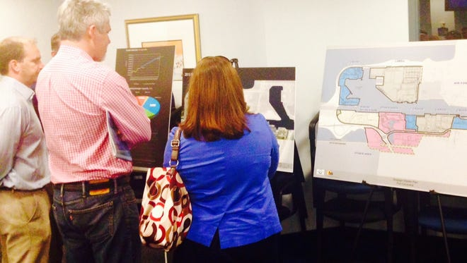 Participants check out the displays at an open house Thursday at Port Canaveral's Maritime Center related to the port's 20-year strategic master plan.