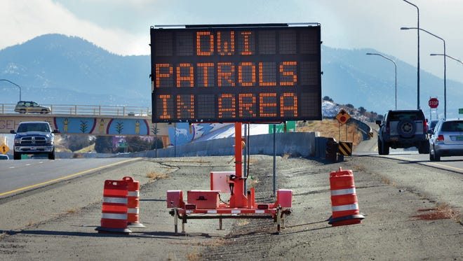 A road sign warning motorists about DWI patrols is shown on between streets recently.
