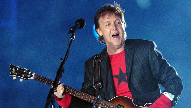 British rock legend Paul McCartney performs at halftime of Super Bowl XXXIX 06 February 2005 at Alltel Stadium in Jacksonville, FL.   AFP PHOTO/Roberto SCHMIDT ORG XMIT: BOB27