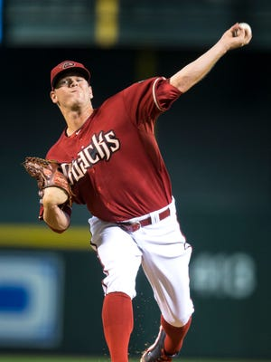 Diamondbacks starting pitcher Andrew Chafin throws in the first inning as the D-Backs play the San Francisco Giants at Chase Field in Phoenix, on Wednesday, Sept. 17, 2014.