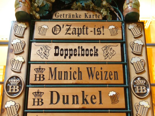 Different kinds of beers are listed on a sign at the Hofbrauhaus Newport restaurant.