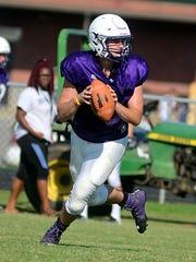 Portland High junior quarterback Brandon Meador rolls
