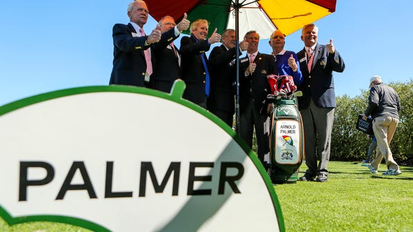 Arnold Palmer Invitational officials pose for a photo with Arnold Palmer's golf bag on Wednesday morning, March 15, 2017,  at the Arnold Palmer Invitational golf tournament in Orlando, Fla.  (Jacob Langston/Orlando Sentinel via AP)