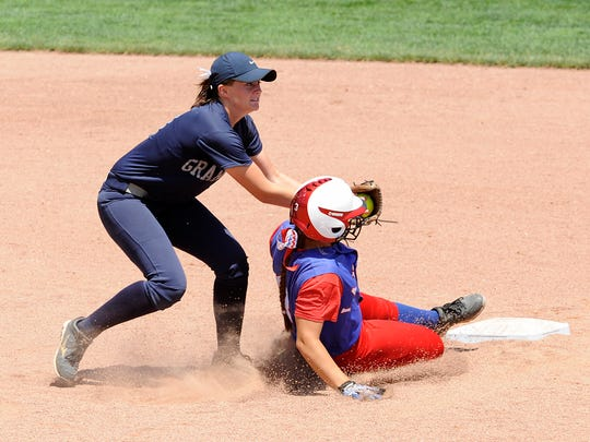 Granville junior shortstop Shelby Sprouse tags out Lakewood runner Brenna Brownfield at second base. The Blue Aces defeated the Panthers 2-1 in the Division II state softball championship on Saturday, June 6, 2015, at Firestone Park Stadium.