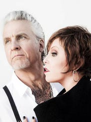 Pat Benatar and husband Neil Giraldo perform together