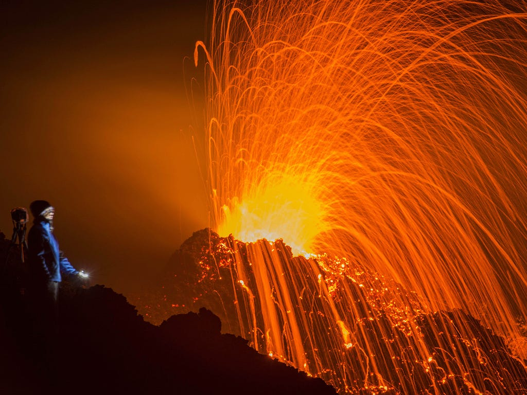 A person watches an eruption at the Piton de la Fournaise volcano on Feb. 5 on La Reunion island in the Indian Ocean.