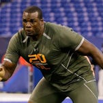 Alabama left tackle Cyrus Kouandjio was taken in the second round by the Buffalo Bills.