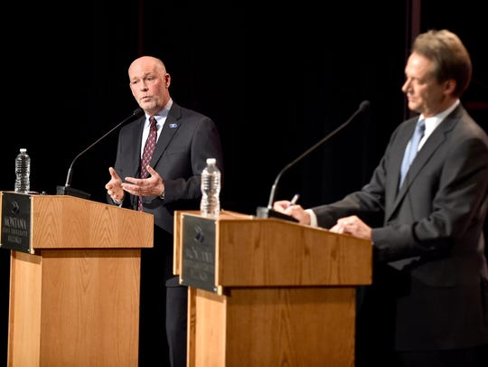 Greg Gianforte, left, makes a point during the Montana