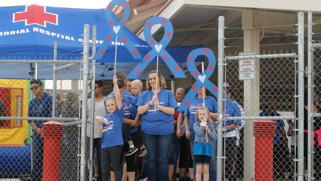 """Crystal Gonzales led the inaugural Autism Awareness Walk around Voiers """"Pit"""" Park in Deming on April 7, 2018."""