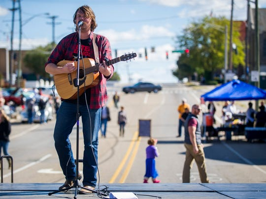 Musician Taylor Corum performs Saturday, Oct. 22, 2016, during Happy Hollerpalooza in Knoxville. The free festival featured live music, arts and crafts, food trucks and more.