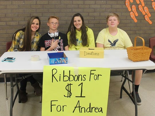 This April 1, 2015 photo is of 10th-grade students at Washington Academy & High School in Princess Anne who sold yellow ribbons as a fundraiser for the family of Andrea Nichole Joyner, a 15-year-old 10th grader at Crisfield Academy & High School who died March 27 in a vehicle accident. Pictured from left are Hannah Eccard, Timmy McCoy, Jessica Wells and Gregory Schenck. In all, county students raised more than $700 in two days for the Joyner family.